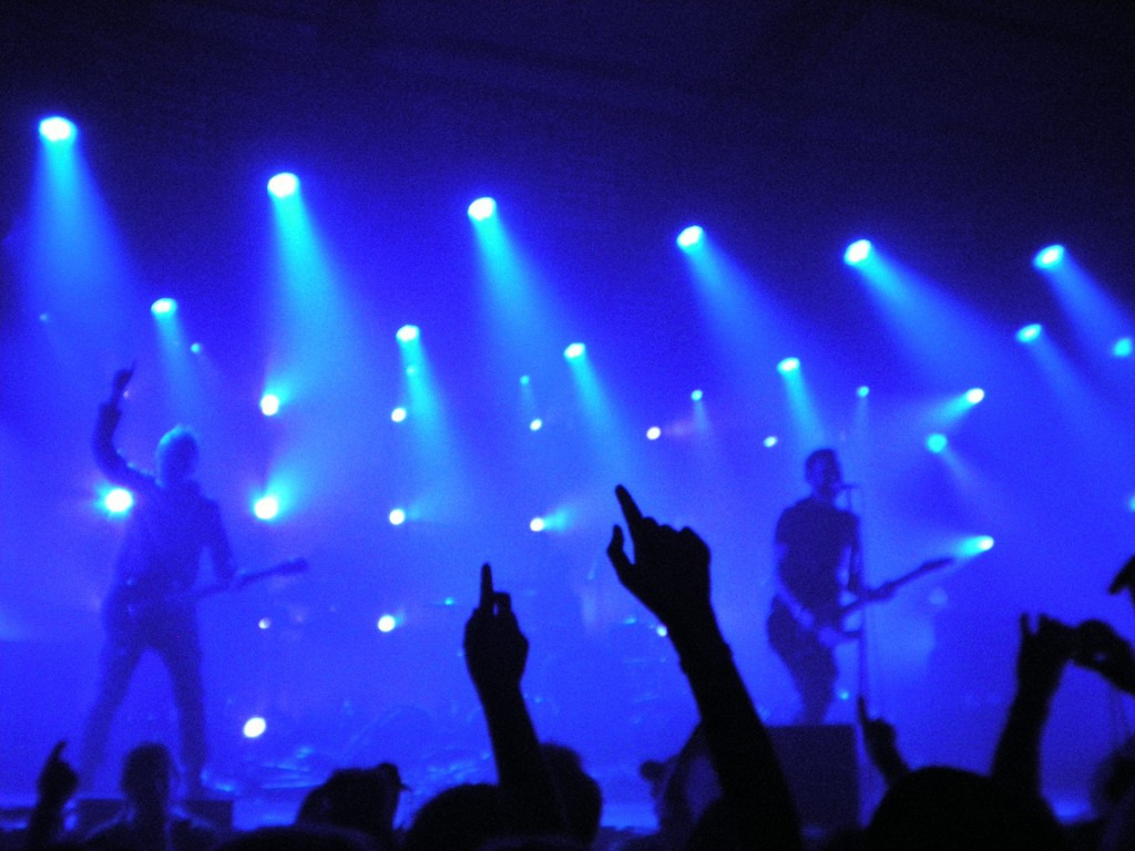 A live band performing under blue lights
