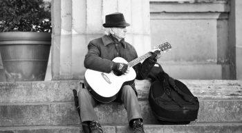 street-musician-playing-a-quitar